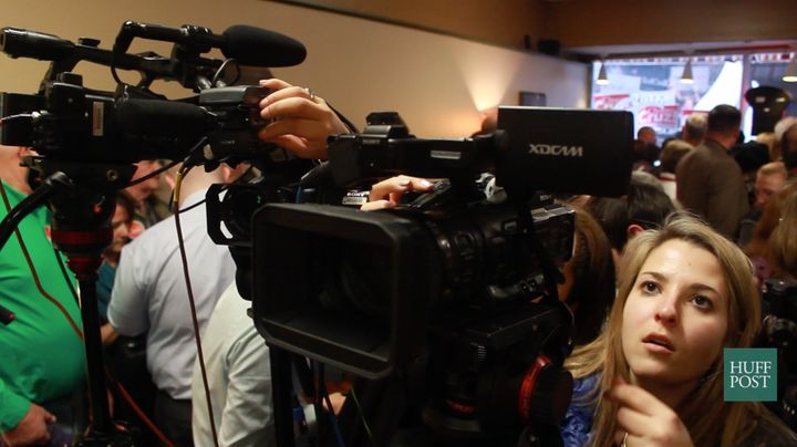 Betsy Klein, a CNN video producer, adjusts her camera before a campaign event in Charles City, Iowa on Jan. 8, 2016.