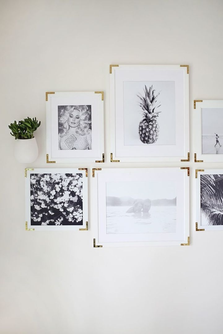 "Freshen up old frames with this gold hardware DIY by <a href=""http://www.abeautifulmess.com/2015/11/try-this-update-simple-frames-with-gold-hardware.html"" target=""_blank"">A Beautiful Mess</a>.&nbsp;"