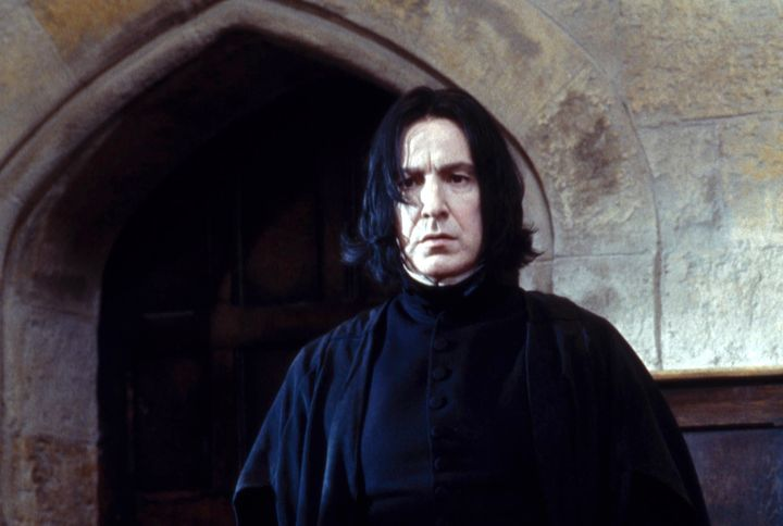 "Alan Rickman as Severus Snape in the film ""Harry Potter and the Sorcerer's Stone."" He went on to play Snape throughout the mo"