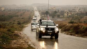 IDLIB, SYRIA - JANUARY 11: Red Crescent convoy, carrying humanitarian aid, pass along the road in Fu'ah town of Idlb, Syria on January 11, 2016. Opposition let the convoy to the town after UNs refugee agency (UNHCR), for its part, said negotiations with the regime concluded with agreement to send a humanitarian convoy into the regime sieged town, Madaya. (Photo by Abdurahman Sayed/Anadolu Agency/Getty Images)