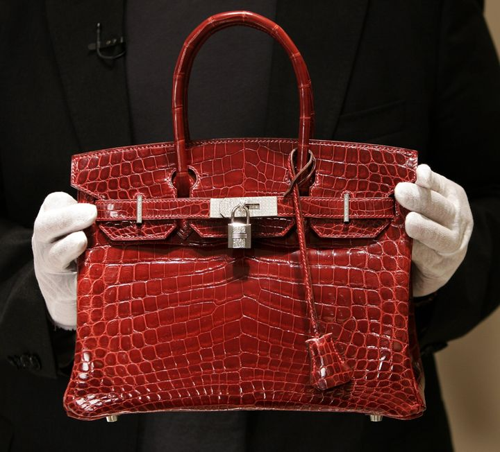 A Crocodile Hermes Birkin Bag Priced At 129 000 Is Seen During The Opening Of