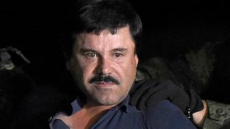 TOPSHOT - Drug kingpin Joaquin 'El Chapo' Guzman is escorted into a helicopter at Mexico City's airport on January 8, 2016 following his recapture during an intense military operation in Los Mochis, in Sinaloa State. Mexican marines recaptured fugitive drug kingpin Joaquin 'El Chapo' Guzman on Friday in the northwest of the country, six months after his spectacular prison break embarrassed authorities.   AFP PHOTO / ALFREDO ESTRELLA / AFP / ALFREDO ESTRELLA        (Photo credit should read ALFREDO ESTRELLA/AFP/Getty Images)