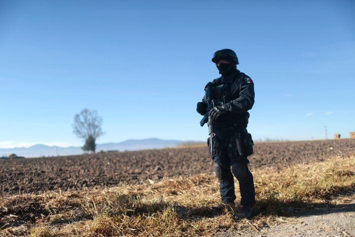 A Mexican federal policeofficer stands guard near the prison where Guzmánwas readmitted onJan. 9, 20