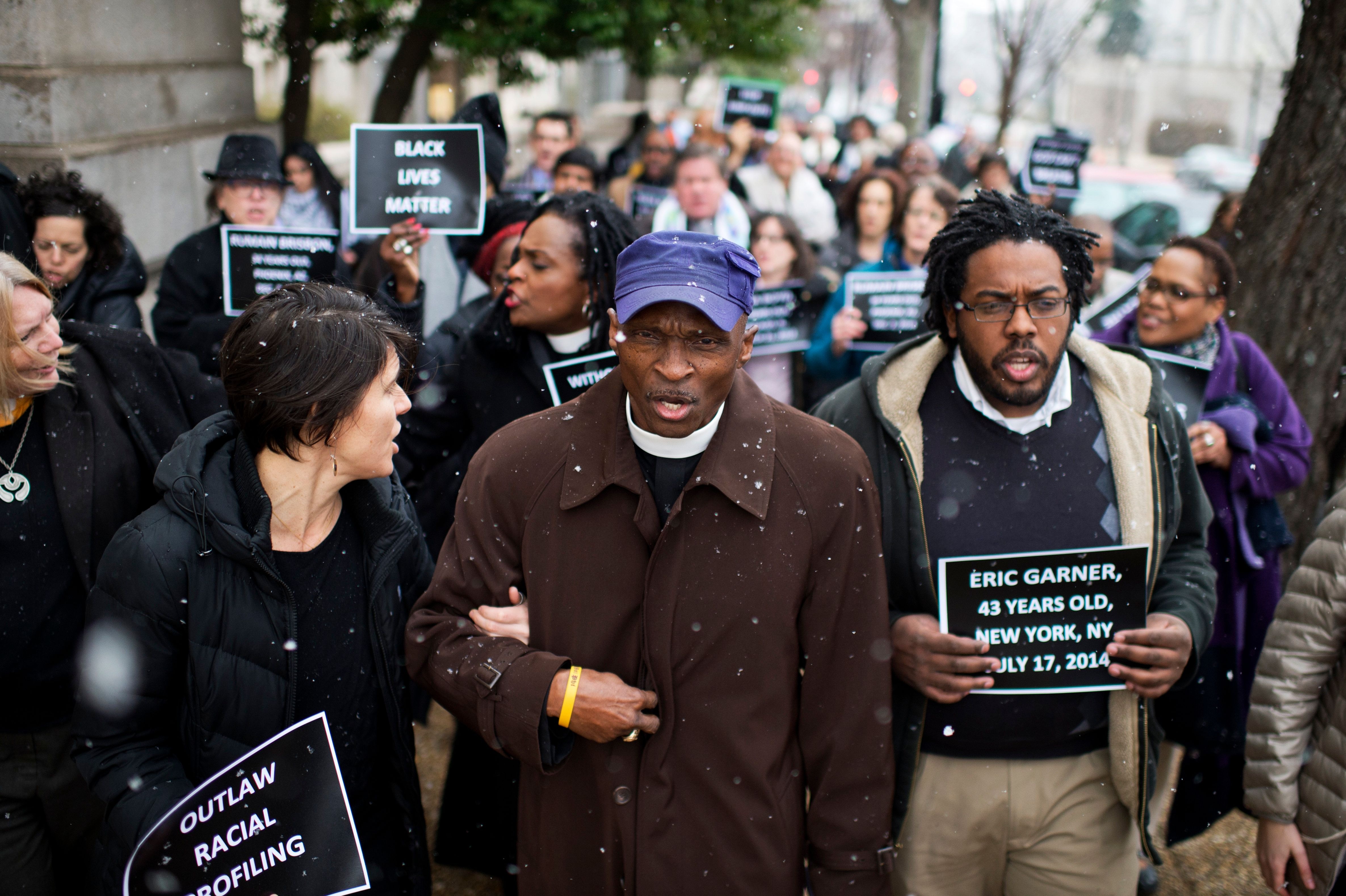 UNITED STATES - JANUARY 21: Rev. Dr. T. Anthony Spearman, center, of North Carolina, and other protesters representing the Black Lives Matter movement, march to the Capitol after a 'die in' in the Longworth cafeteria to call on Congress to take action on racial issues, January 21, 2015. (Photo By Tom Williams/CQ Roll Call)