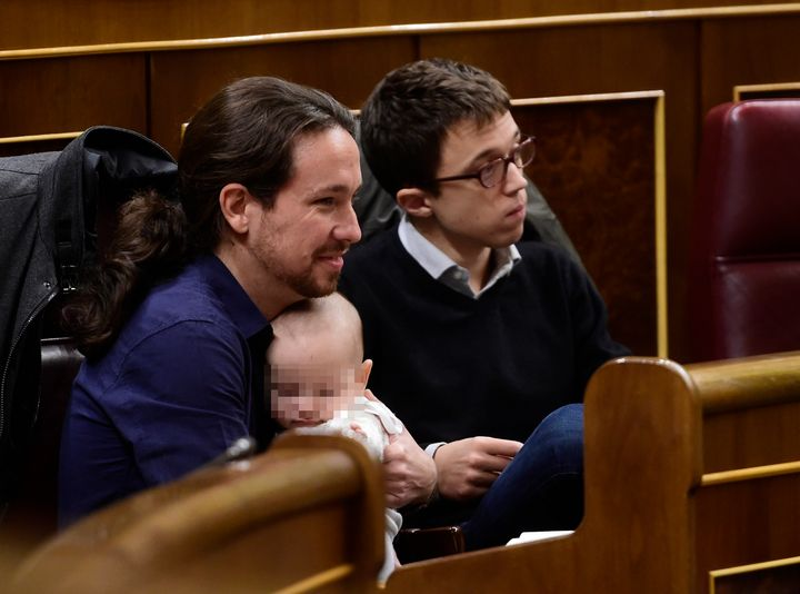 Podemos' leader Pablo Iglesias snuggles with Diego, whose face Bescansa asked not be photographed.