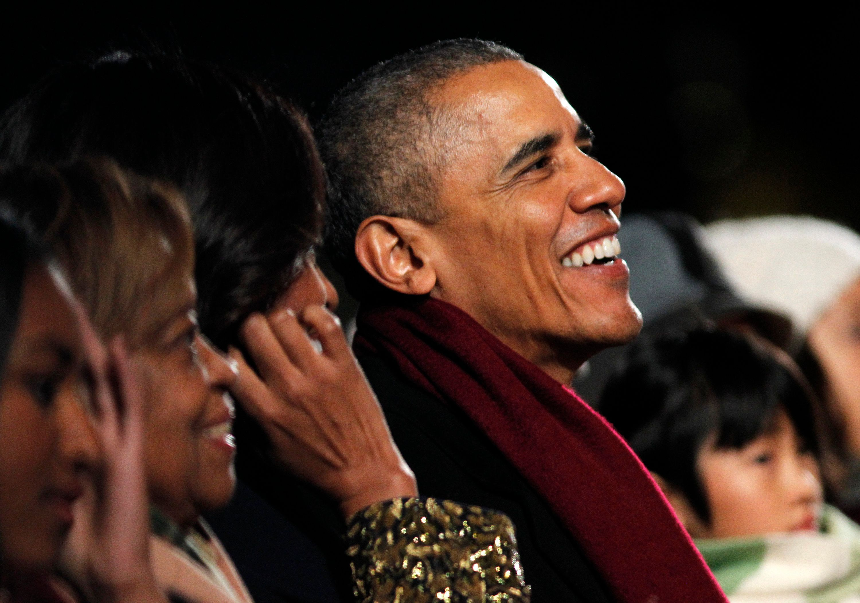 WASHINGTON, DC - DECEMBER 03:  U.S. President Barack Obama (R) shares a laugh with First Lady Michelle Obama during the 93rd Annual National Christmas Tree Lighting at The Ellipse on December 3, 2015 in Washington, DC.  (Photo by Paul Morigi/Getty Images)