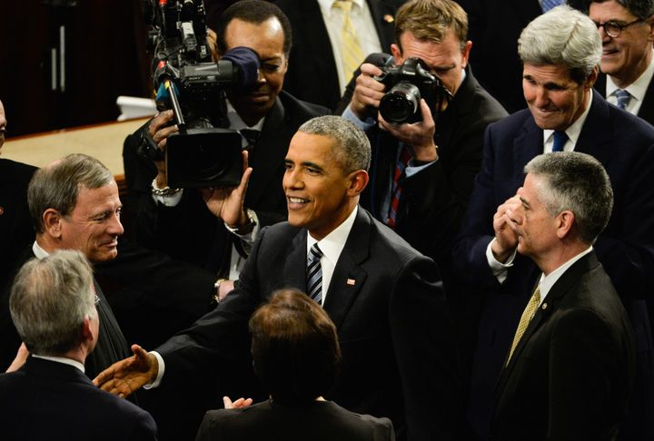 President Barack Obama smiles his way through one more of these.