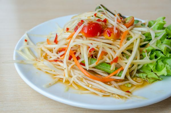 This refreshing salad made with shredded unripe papaya can be found throughout Southeast Asia. It is most often seasoned&nbsp
