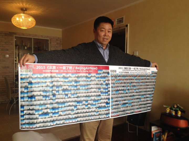 Zou holds up collages of his photos at his home in Beijing.