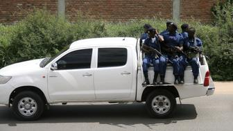 Military personnel sits aboard a vehicle driving through the Musaga neighbourhood of the city of Bujumbura on December 11, 2015. Heavily-armed gunmen launched coordinated assaults on three army barracks in the Burundian capital on December 11 leaving at least a dozen dead in the worst unrest since a failed May coup. / AFP / STRINGER        (Photo credit should read STRINGER/AFP/Getty Images)