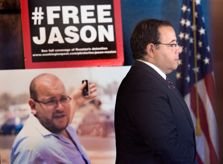 Ali Rezaian, the brother of imprisoned Washington Post journalist Jason Rezaian (shown in the poster), gives reporters a