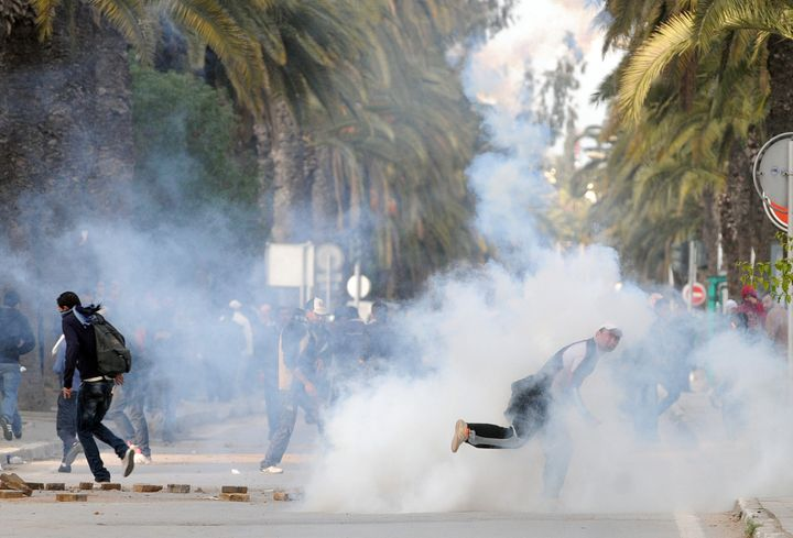 A Tunisian demonstrator throws a rock during clashes with security forces on Mohamed V Avenue in Tunis on Jan. 14, 2011.