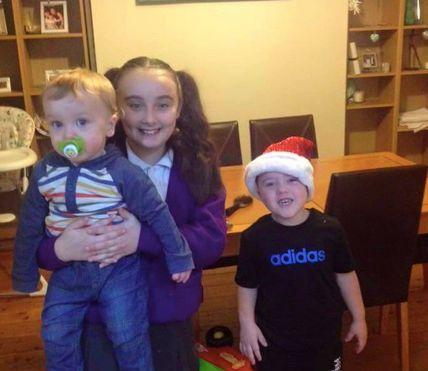 Archie posing with his big sister, Kellsie and big brother, Alfie.