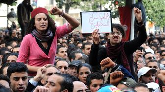 Tunisians shout slogans during a protest rally in front the Interior ministry in Habib Bourguiba avenue in Tunis after Tunisian President Zine El Abidine Ben Ali's address to the nation on January 14, 2011. Thousands of Tunisians demanded the departure of President Zine El Abidine Ben Ali in marches in the capital and other towns, a day after he pledged to not seek another term to end growing unrest. AFP PHOTO / FETHI BELAID (Photo credit should read FETHI BELAID/AFP/Getty Images)