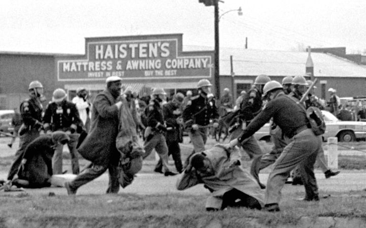 In this March 7, 1965, photo, state troopers use clubs against participants in a civil rights march in Selma, Alabama.&n