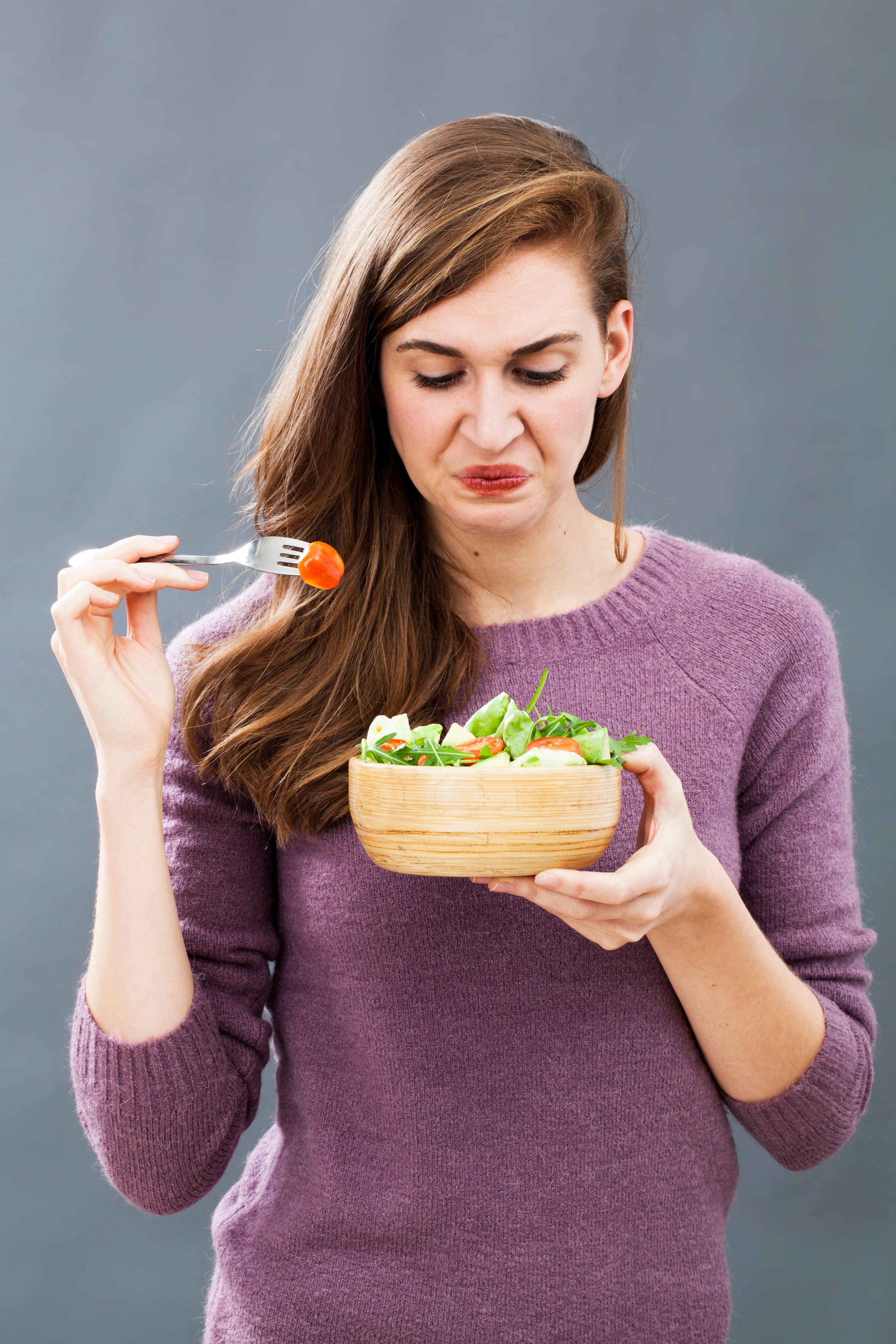 picky 20s woman developing aversion in eating raw vegetables