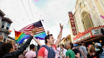 SAN FRANCISCO, CA - JUNE 27: People cheer as pink confetti falls from the sky during a gay pride celebration on June 27, 2015 in San Francisco, California. The Supreme Court ruled that same-sex couples have a constitutional right to marry nationwide without regard to their state's laws. (Photo by Elijah Nouvelage/Getty Images)
