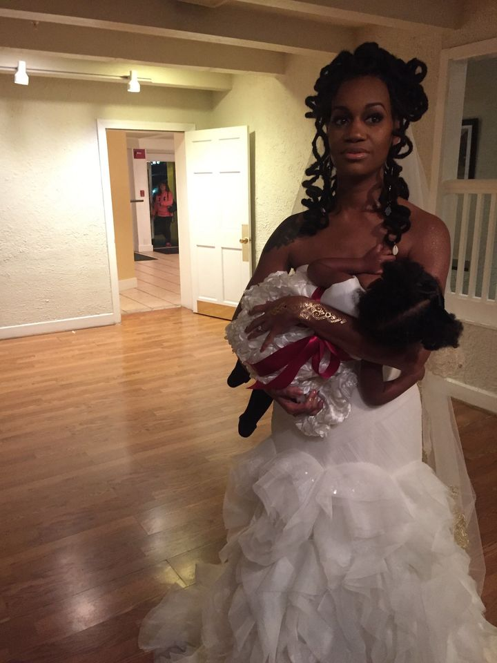 Brandi Chantalle breastfeeding Zora on her wedding day.