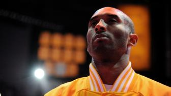 LOS ANGELES, CA - JANUARY 13: Kobe Bryant #24 of the Los Angeles Lakers stands for the national anthem before a game against the Miami Heat on January 13, 2015 in Los Angeles, California. NOTE TO USER: User expressly acknowledges and agrees that, by downloading and/or using this Photograph, user is consenting to the terms and conditions of the Getty Images License Agreement. Mandatory Copyright Notice: Copyright 2015 NBAE (Photo by Andrew D. Bernstein/NBAE via Getty Images)