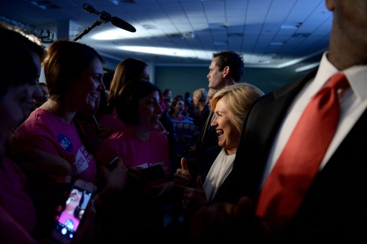 Journalists can try asking Hillary Clinton questions when she greets supporters on the rope line.