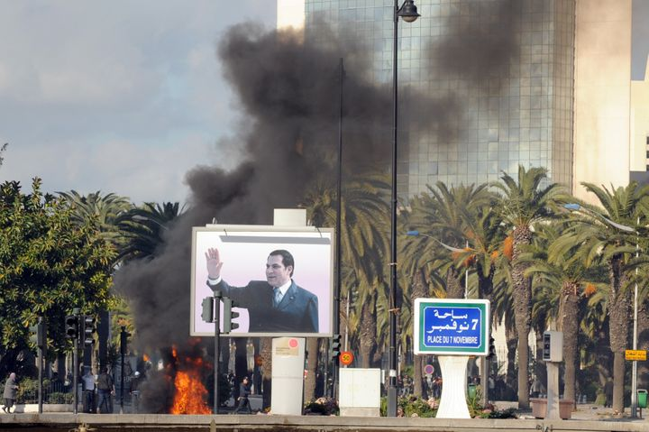 Smoke rises from fire left after clashes between security forces and demonstrators in Tunis on Jan. 14, 2011.