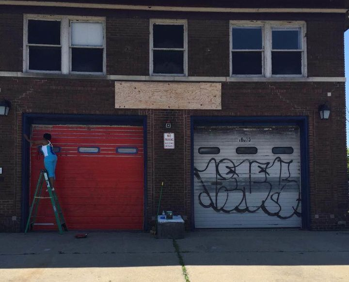 Erinn Currie, executive assistant for Liquid Flow, paints the former firehouse that will soon become a space for arts educati