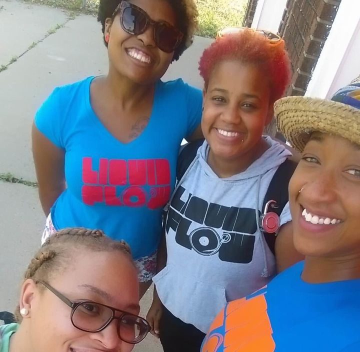 Liquid Flow Media Arts Center founder Stacy'e Jones, in gray, takes a selfie with her team while they shoot a promotional vid