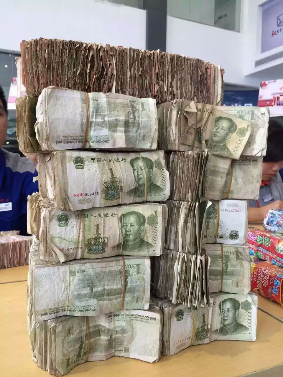 ZHANJIANG, CHINA - JANUARY 11: (CHINA OUT) RMB One yuan notes brought by a citizen who saves 100,000 yuan notes to buy a van are seen at a 4S store on January 11, 2016 in Zhanjiang, Guangdong Province of China. The citizen drove a small truck to carry these notes whose denominations are mostly RMB five Jiao, RMB two Jiao, RMB one Jiao and a small fraction of RMB one Yuan. It's said that the van the citizen wants to purchase costs more than ninety thousand and he paid for it in one lump sum. (Photo by ChinaFotoPress/ChinaFotoPress via Getty Images)