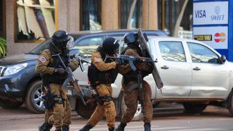 Special police forces are seen during search operations following an attack by Al-Qaeda linked gunmen on January 16, 2016 in Ouagadougou.  Security forces in Burkina Faso on January 16 completed a counter-offensive against jihadist assailants who stormed a top hotel and a restaurant in the capital hours earlier, a security source said. The source said security forces were continuing search operations in the area around the Splendid hotel and nearby Cappuccino restaurant, which were attacked by the Al-Qaeda-linked gunmen late on January 15, killing at least 23 people. / AFP / AHMED OUOBA        (Photo credit should read AHMED OUOBA/AFP/Getty Images)