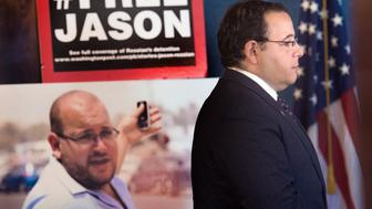WASHINGTON, DC - JULY 22:    Ali Rezaian, brother of imprisoned Washington Post's Iran bureau chief Jason Rezaian (in poster), gives reporters an update on his brother's case at the Naitonal Press Club in Washington, DC on July 22, 2015.  It has been one year since American Iranian journalist Jason Rezaian was detained then imprisoned fon charges of espionage and propaganda against the Iranian establishment.   He remains at Evin Prison in Tehran despite diplomatic pleas for his release.  (Photo illustration Linda Davidson / The Washington Post via Getty Images)