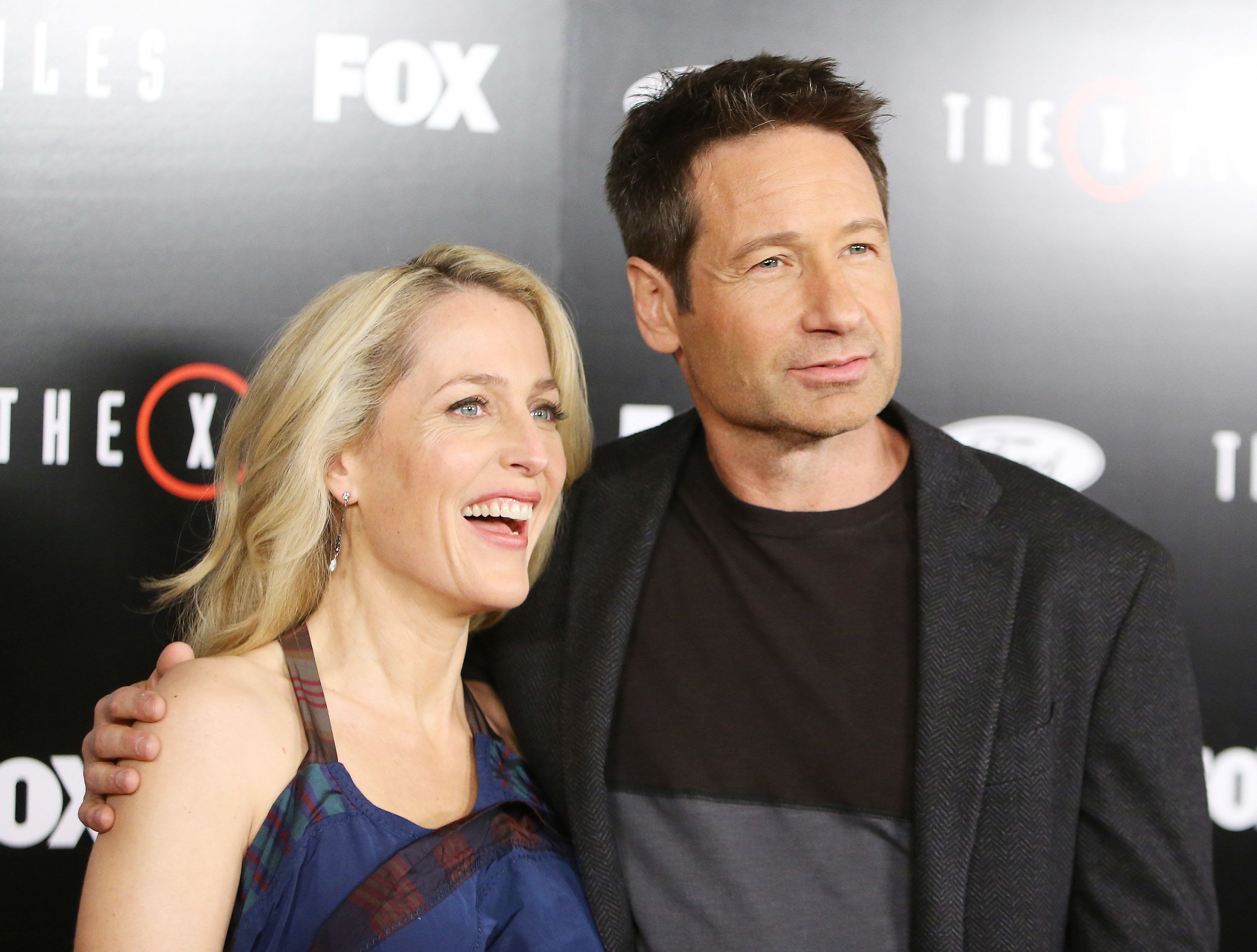 LOS ANGELES, CA - JANUARY 12:  Gillian Anderson (L) and David Duchovny arrive at the Los Angeles premiere of Fox's 'The X-Files' held at California Science Center on January 12, 2016 in Los Angeles, California.  (Photo by Michael Tran/FilmMagic)