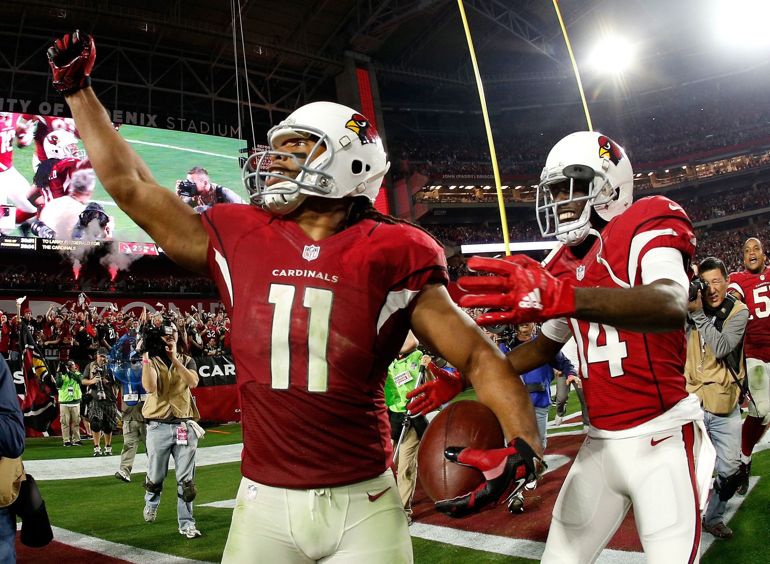 GLENDALE, AZ - JANUARY 16: Wide receiver Larry Fitzgerald #11 of the Arizona Cardinals celebrates his game winning touchdown in overtime with wide receiver J.J. Nelson #14 (right) during the NFC Divisional Playoff Game at University of Phoenix Stadium on January 16, 2016 in Glendale, Arizona. The Arizona Cardinals beat the Green Bay Packers 26-20. (Photo by Christian Petersen/Getty Images)