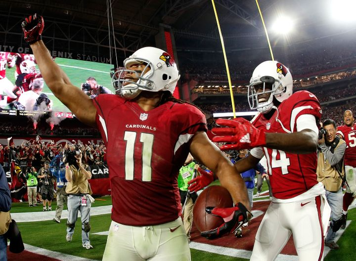 Wide receiver Larry Fitzgeraldcelebrates his game-winning touchdown right after the NFC Divisional Playoff Game at University