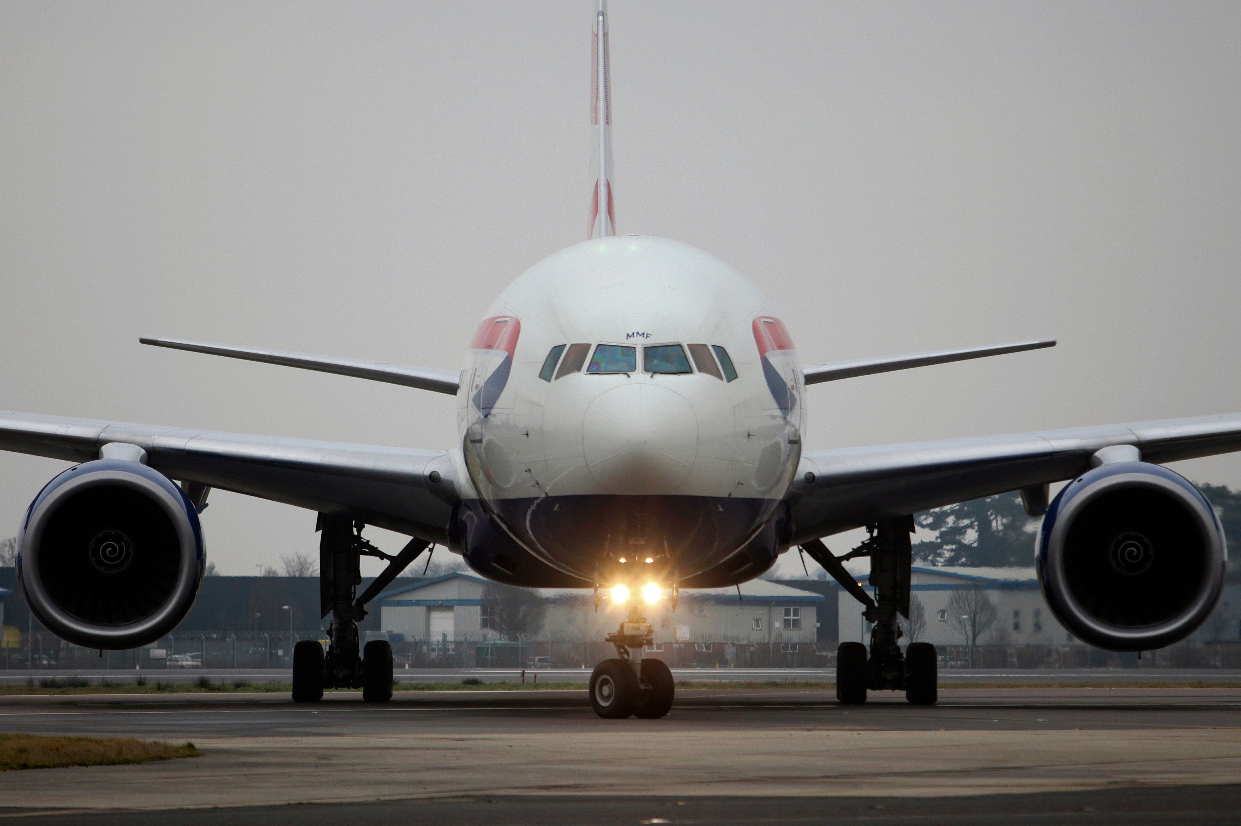 A British Airways aircraft taxis on the tarmac at Gatwick airport in Crawley, U.K., on Thursday, Jan. 10, 2013. Gatwick, acquired by Global Infrastructure Partners Ltd. in 2009 after regulators sought a breakup of BAA Ltd., owner of the larger Heathrow hub, is 30 miles (48 kilometers) south of London and serves about 200 destinations, more than any other U.K. airport, according to flight schedule data provider OAG. Photographer: Chris Ratcliffe/Bloomberg via Getty Images