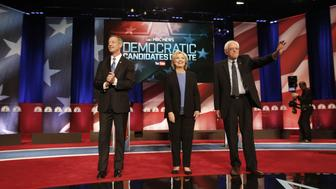 2016 Democratic presidential candidates Martin O'Malley, former governor of Maryland, from left, Hillary Clinton, former Secretary of State, and Senator Bernie Sanders, an independent from Vermont, acknowledge the crowd during the Democratic presidential candidate debate in Charleston, South Carolina, U.S., on Sunday, Jan. 17, 2016. Hours before Sunday's Democratic debate, the two top Democratic contenders held a warm-up bout of sorts in multiple separate appearances on political talk shows, at a time when the polling gap between the pair has narrowed in early-voting states. Photographer: Patrick T. Fallon/Bloomberg via Getty Images