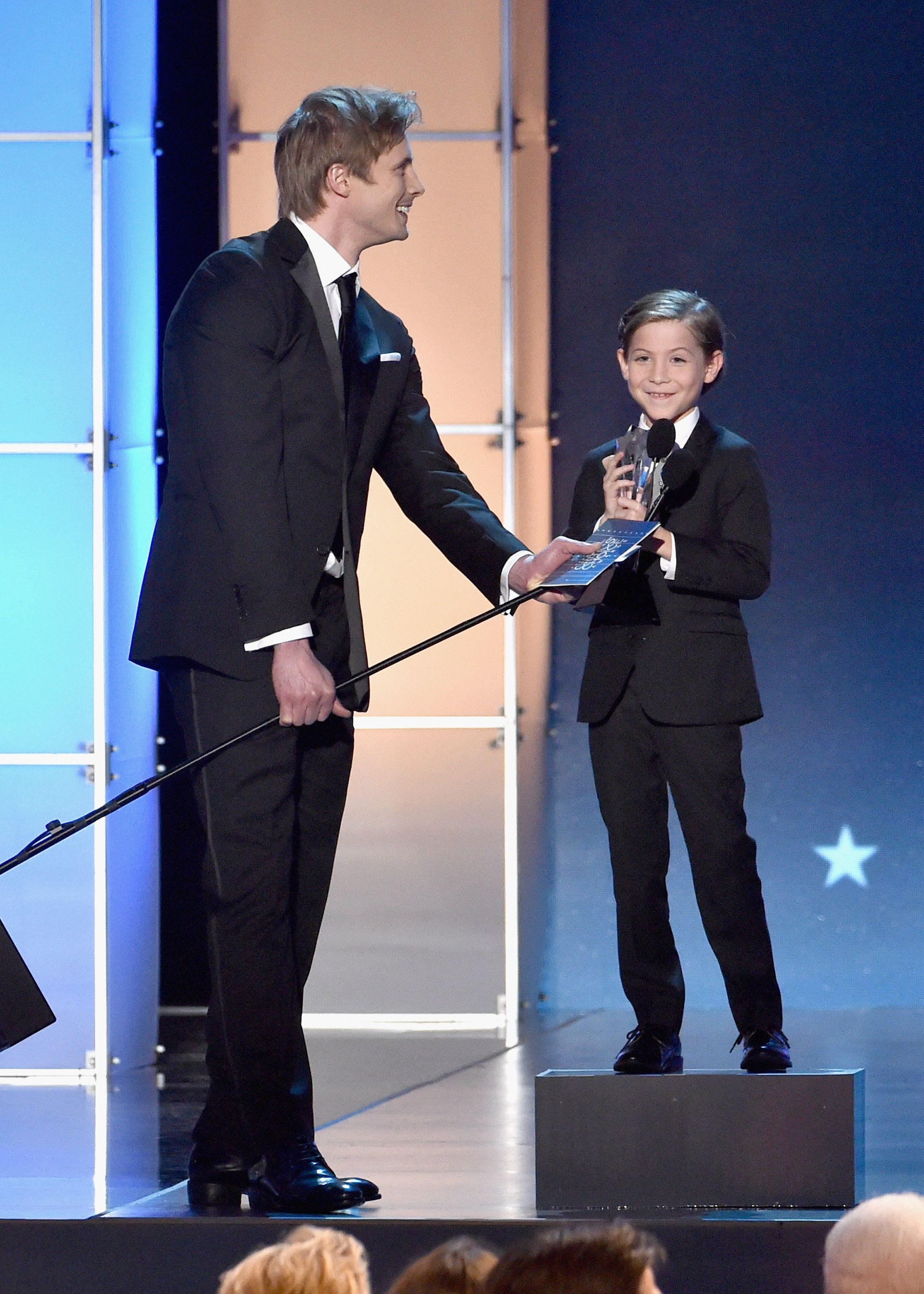 SANTA MONICA, CA - JANUARY 17: Actors Bradley James (L) and Jacob Tremblay, winner of Best Young Actor/Actress for 'Room,' onstage during the 21st Annual Critics' Choice Awards at Barker Hangar on January 17, 2016 in Santa Monica, California.  (Photo by Lester Cohen/WireImage)