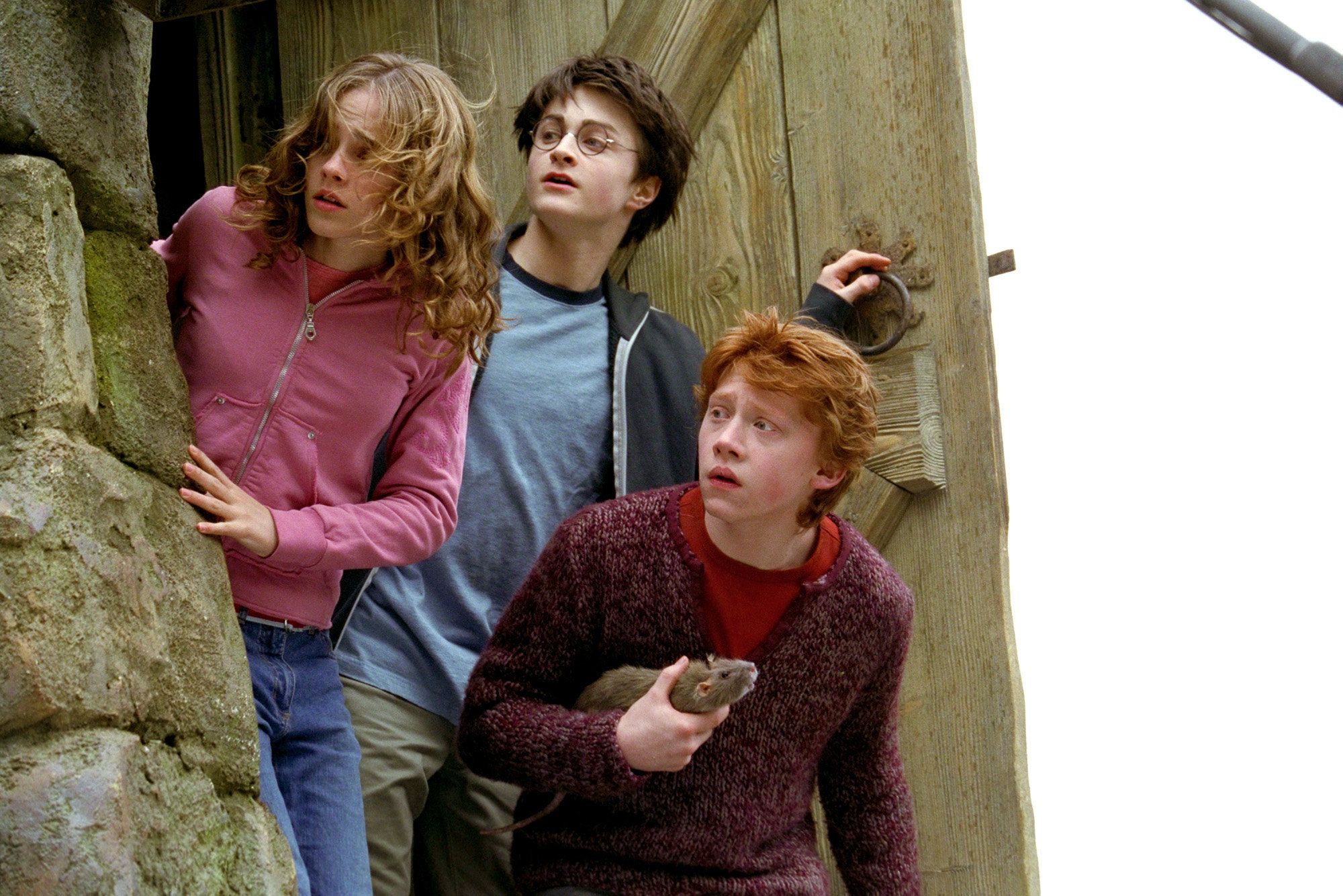 (Left to right) Emma Warson (Hermoine Granger), Daniel Radcliffe (Harry  Potter) and Rupert Grint (Ron Weasley), in the movie HARRY  POTTER  AND THE PRISONER OF AZKABAN. Photo credit: Murray Close / Warner Bros. Pictures