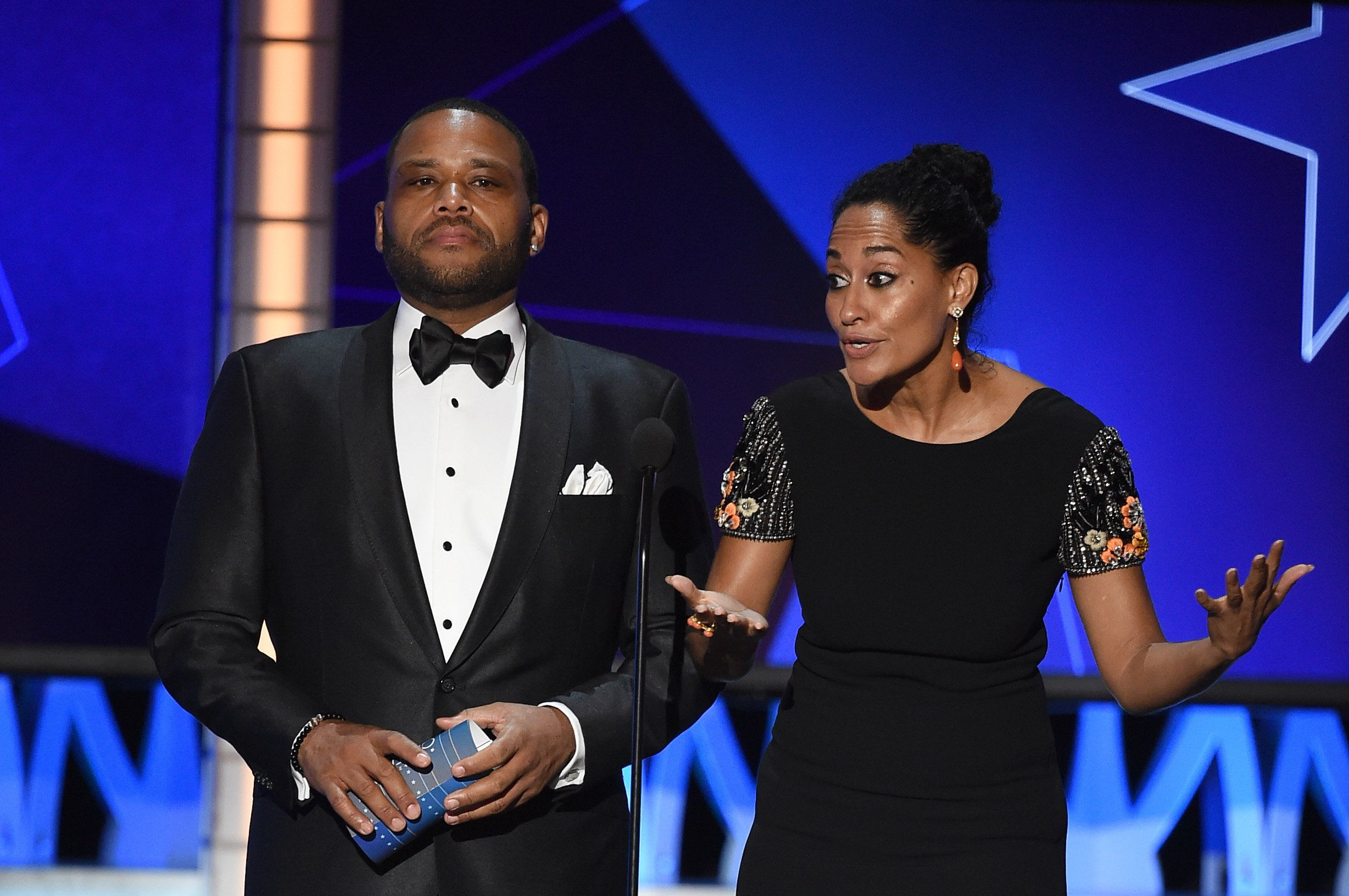 SANTA MONICA, CA - JANUARY 17:  Actors Anthony Anderson (L) and Tracee Ellis Ross speak onstage during the 21st Annual Critics' Choice Awards at Barker Hangar on January 17, 2016 in Santa Monica, California.  (Photo by Kevin Winter/Getty Images)