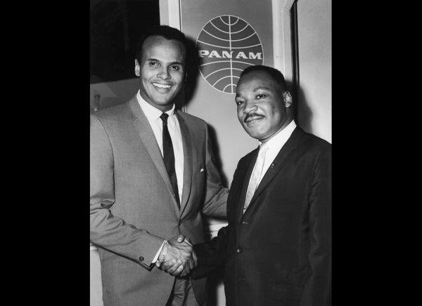 American singer and actor Harry Belafonte Jr. (left) shakes hands with American civil rights leader Rev. Martin Luther King J