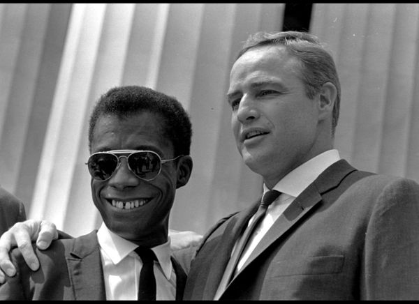 James Baldwin and Marlon Brando on the steps of the Lincoln Memorial at the March on Washington, Aug. 28, 1963. (PhotoQuest /