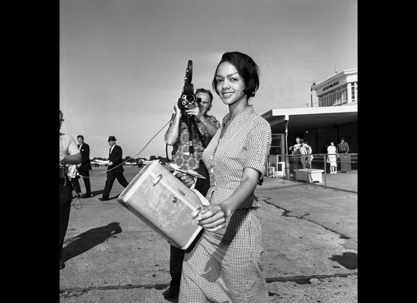 "Lucretia Collins, 21, ""Freedom Rider"" from Fairbanks, Alaska, walks to plane in Jackson, May 27, 1961, after being freed from"