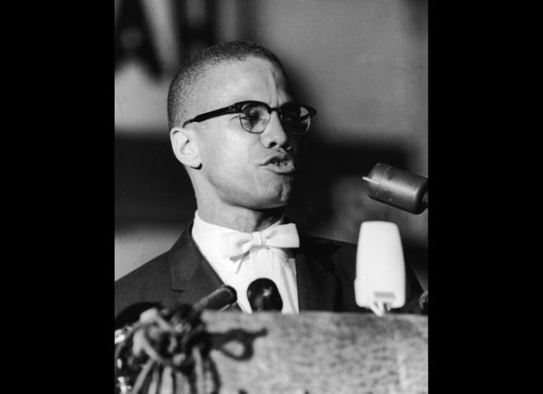 American political activist and radical civil rights leader, Malcolm X (1925 - 1965) speaks from a podium during a rally of A