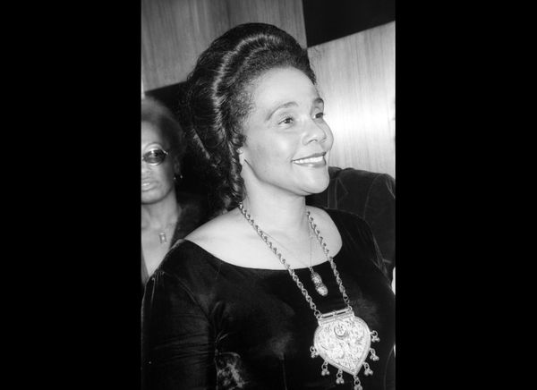 American Civil Rights activist Coretta Scott King (1927 - 2006) smiles as she attends a party in honor of the theatrical prod