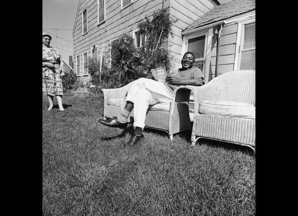 David Harris, the first reverse freedom rider to arrive in Hyannis from Little Rock, Ark., relaxes on lawn of home where he l