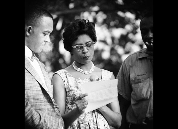 Mrs. L.C. (Daisy) Bates, state President of the NAACP is shown on Aug. 13, 1959 in Little Rock, Ark., as she reads a telegram