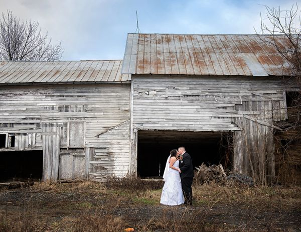 """Tabatha and Morgan Gardner sneak a kiss after coming across a weathered old barn in Ulster, Pennsylvania, on the way to thei"