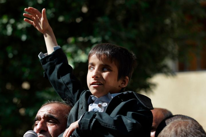 A blind child protests in Sanaa on Jan. 6 against the bombing that damaged the al-Noor Centerfor the Care and Rehabilit