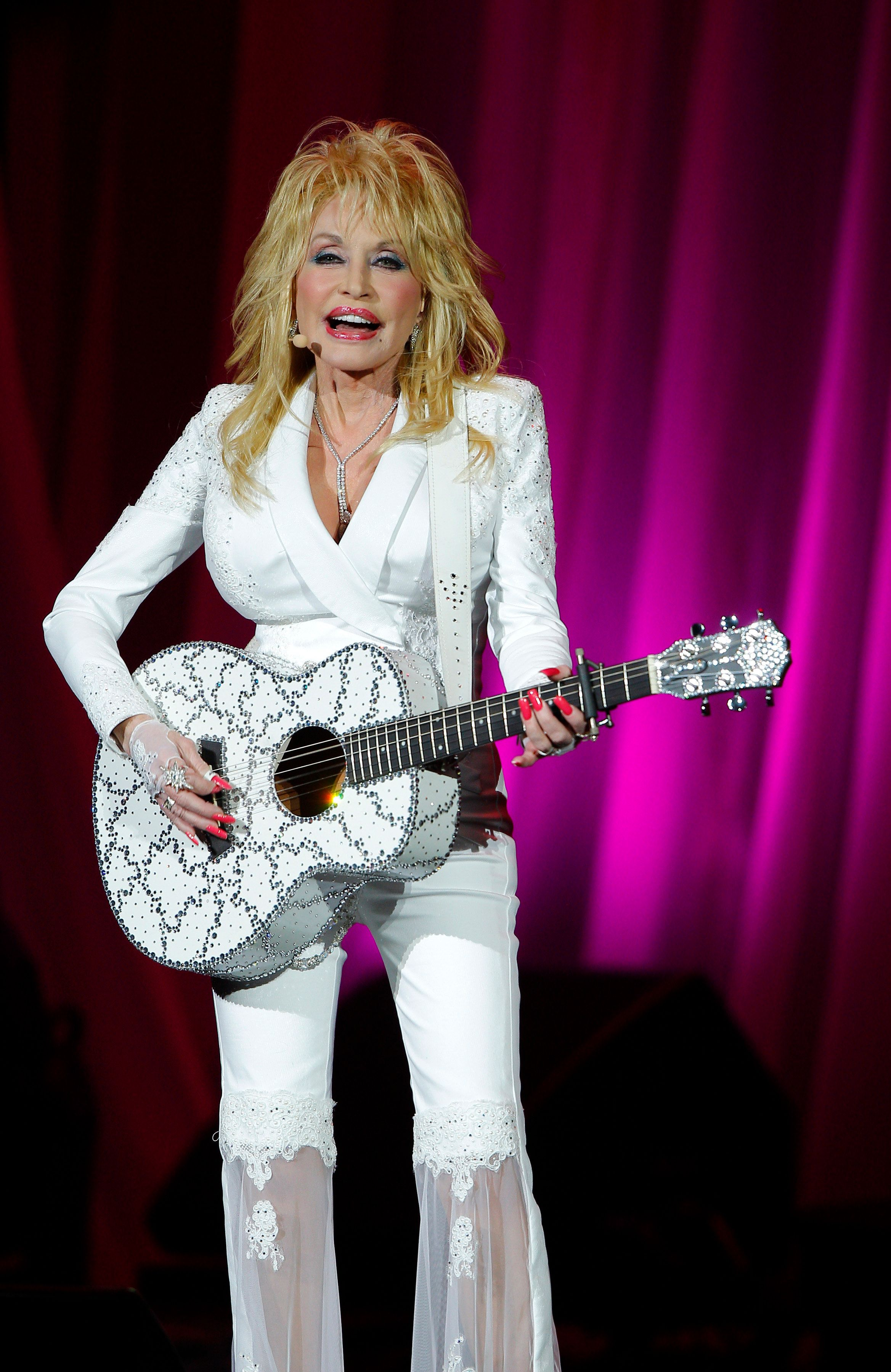 Dolly Parton performs in concert at the Ryman Auditorium on Friday, July 31, 2015 in Nashville, Tenn. (Photo by Wade Payne/Invision/AP)
