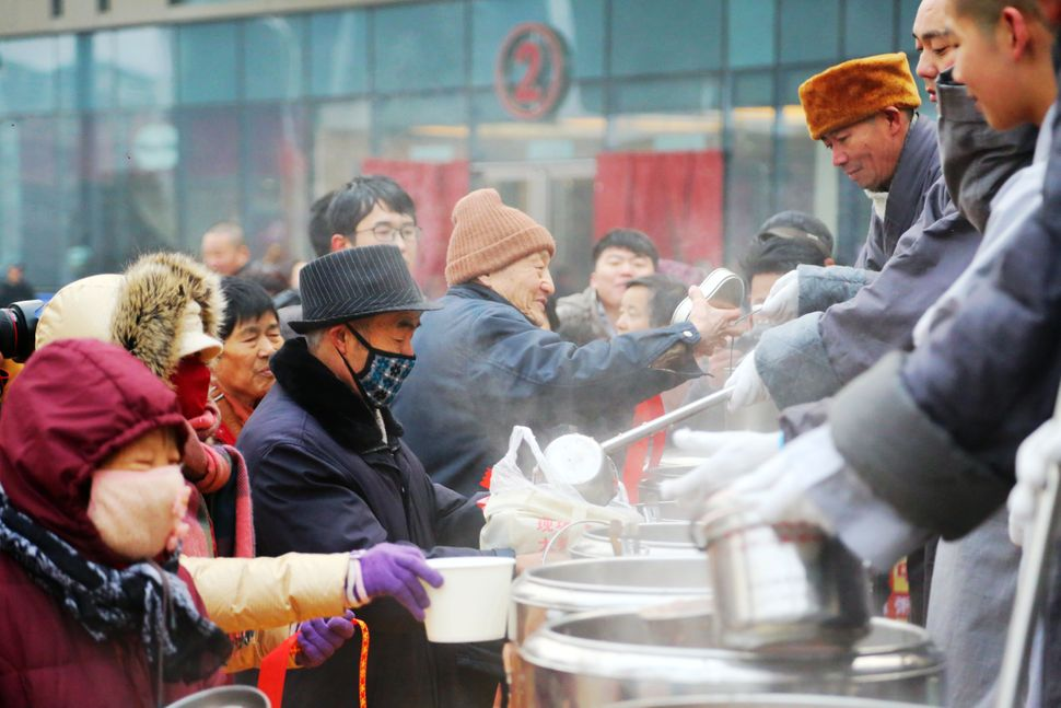 Monks give away Laba congee.