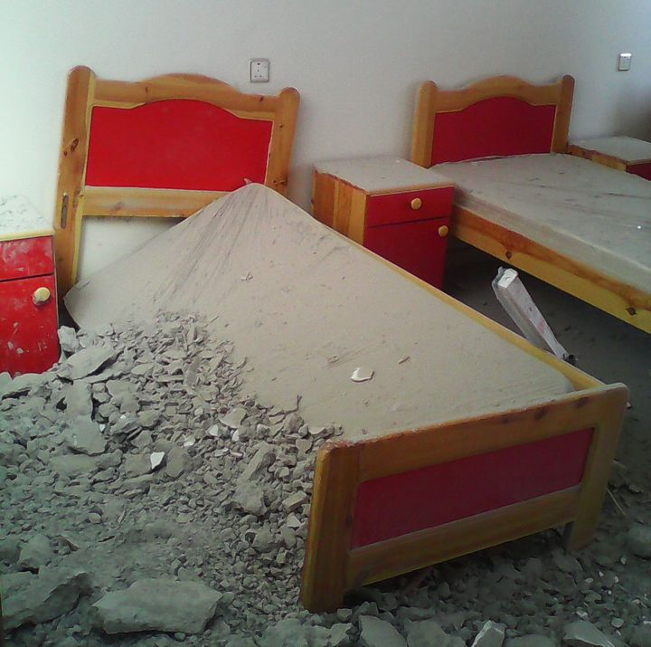 A photo taken right after the airstrike shows the damage toa third-floor bedroom at the al-Noor Center.